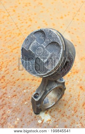 cylinder piston on rusty steel. Vertical image