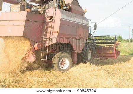 Harvesting of bread by harvesters - harvesting at the end of summer.
