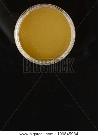 A Smooth Untouched Jar of Peanut Butter