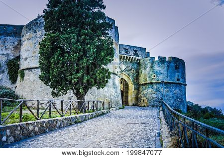 Ancient medieval street leading to Norman castle overlooking the city of milazzo sicily italy