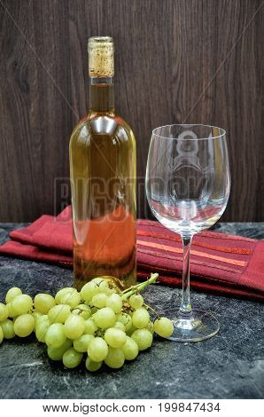 winebottle and glas with grape close up