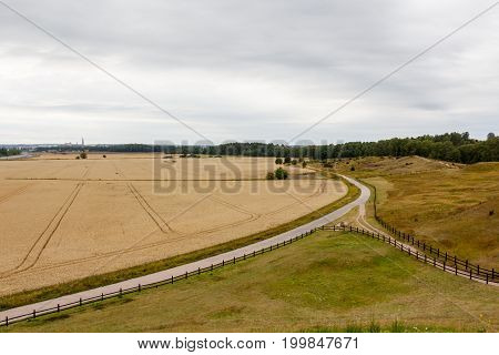 Rural Scenic Landscape With Crossroad On Hill In Forest