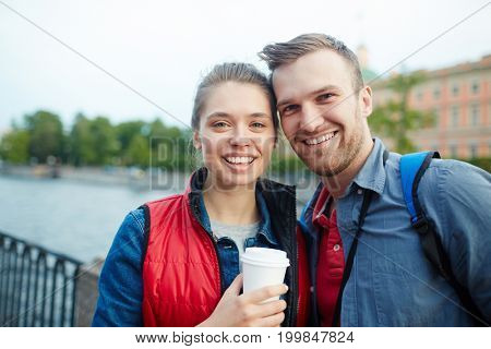 Vacation of amorous couple on travel resort or foreign city