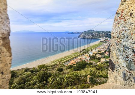Defenses of the Norman castle of milazzo coastline with beaches of the Tyrrhenian Sea and on the horizon you can get to see the outline of the Aeolian Islands
