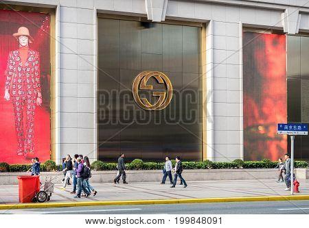 Shanghai, China - Nov 6, 2016: On Najing East Road - Fashion show on huge displays beside the New World Daimaru (Dawan) Department Store.