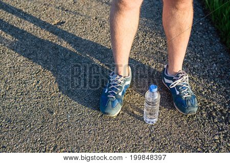 Feet of jogging person in the street