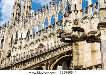 Gargoyle is on the roof of the Milan Cathedral (Duomo di Milano) in Milan, Italy. Milan Duomo is the largest church in Italy and the fifth largest in the world.