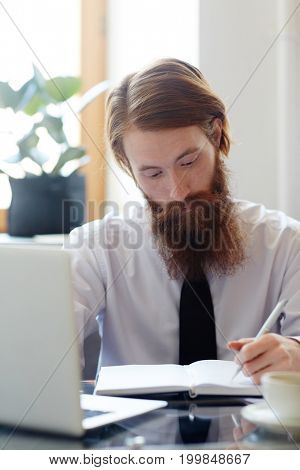 Busy entrepreneur making plan of work for the day