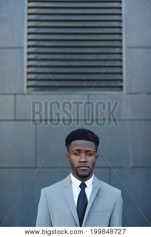 Young lawyer in suit and tie looking at camera