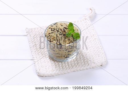 glass of wild rice on white table mat
