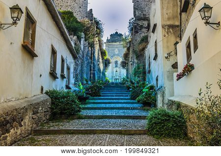 Stairways in a street on the way up and on top the main church of the island of lipari italy