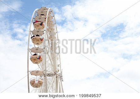 WARNEMUENDE / GERMANY - AUGUST 12 2017: ferris wheel stands at public event on hanse sail in warnemuende germany.