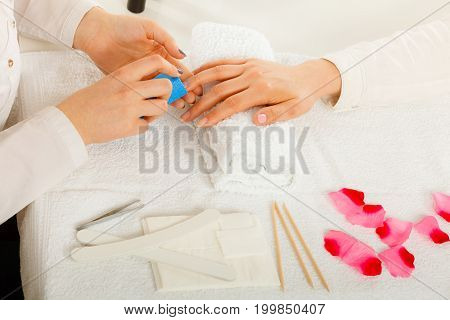 Woman Getting Manicure Done File Nails