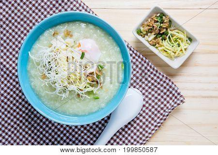 Thai Rice Porridge With Pork On Wood Table,pork Congee