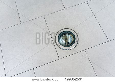 Roung Light In A Light Brown Ceramic Pavement