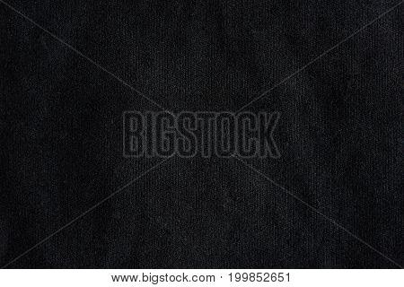 Black abstract fabric background. Dark black cloth texture