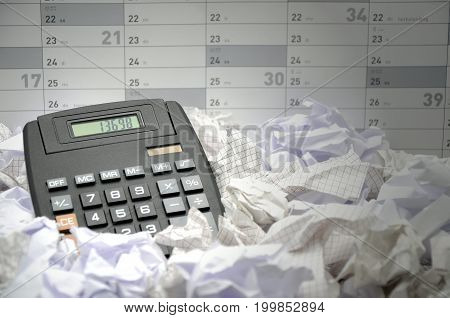 calculator in many papers close up photo