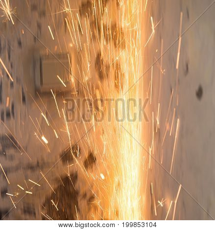 Sparks from cutting metal as a background .