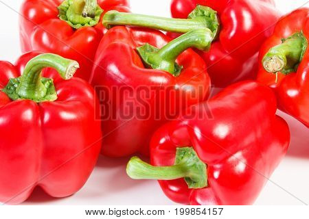 Heap Of Red Ripe Peppers On White Background, Healthy Nutrition