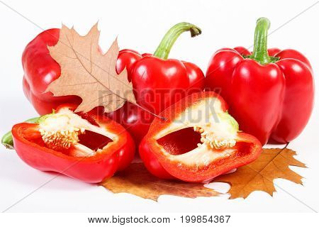 Red Peppers With Autumnal Leaf, Healthy Nutrition And Autumn Concept