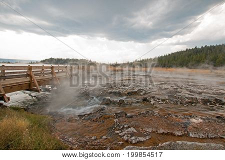 Boardwalk over Hot Cascades hot spring in the Lower Geyser Basin in Yellowstone National Park in Wyoming United States