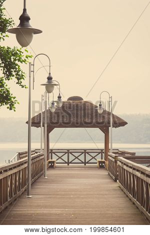 Vintage Photo, Wooden Jetty At Lake On Cloudy Day