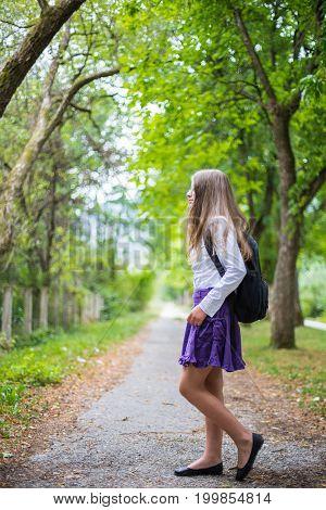 Pretty Beautiful Blonde Child Girl Cheerful And Happily Walking Across Street Back To School Enjoyin
