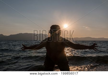 Silhouette of a Woman at the Beach Playing around in Front of the Camera