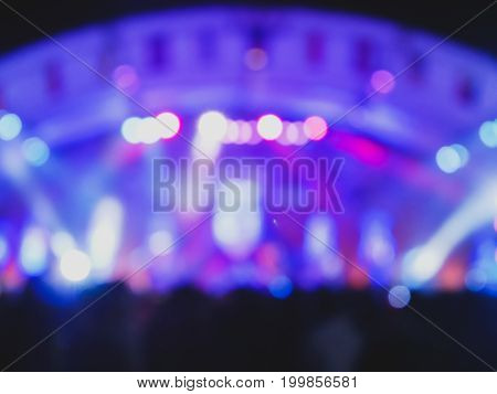 defocused entertainment concert lighting on stage blurred disco party.