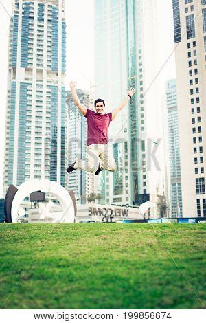 tourist to dubai having fun, jumping high in the air