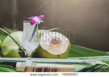 coconut juice and drinking sweet coconut water in glass