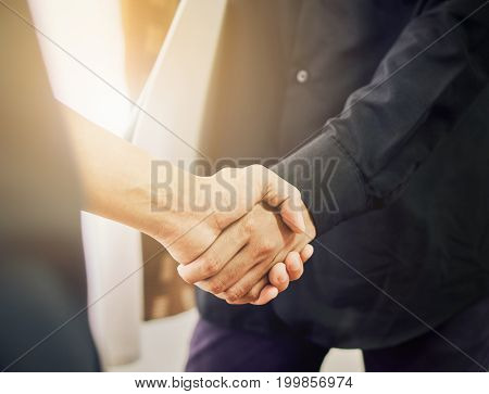 Businessmen are shaking hands after successful negotiations in business The concept of business advancement through collaboration. vintage effect.