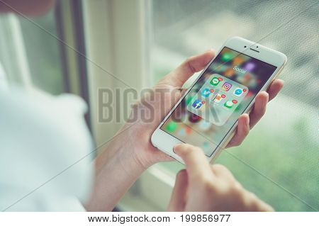 Bangkok, Thailand - August 16, 2017 : woman using iPhone of show display app Social media screen. The phone is a daily necessity.