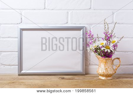 Silver Landscape Frame Mockup With Chamomile And Purple Flowers In Golden Pitcher