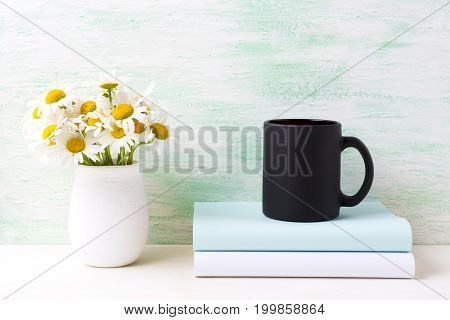 Black Coffee Mug Mockup With White Field Chamomile Bouquet In Handmade Rustic Vase And Books