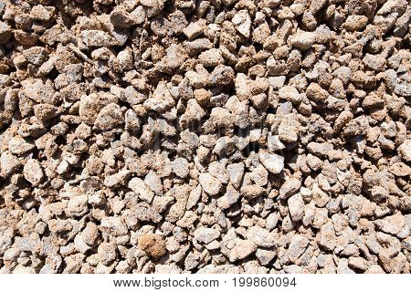 Crushed stone with sand as a background .