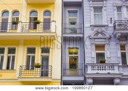 Balconies with flowers pot in the historic center of Karlovy Vary