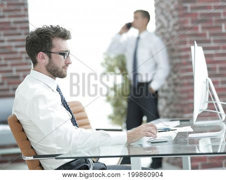 businessman works with business papers