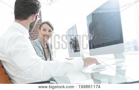 creative designers sitting behind a Desk