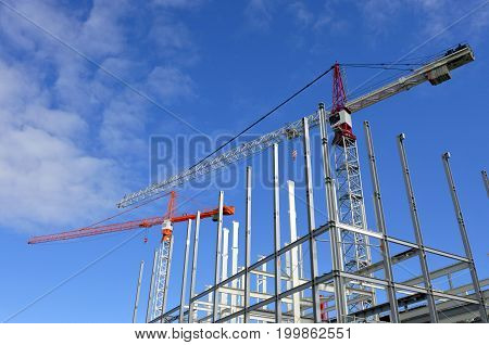 Two Cranes In New Building Site