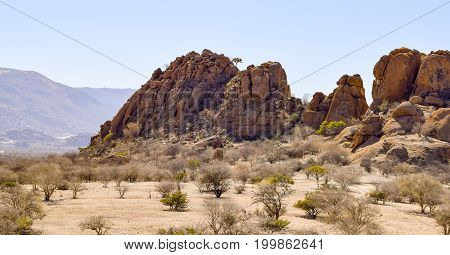 sunny illuminated landscape including a rock formation seen in Namibia Africa