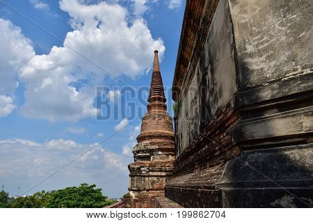 ancient building that build from bricks in the past of Ayuthaya Kingdom with beautiful sky for copy space background