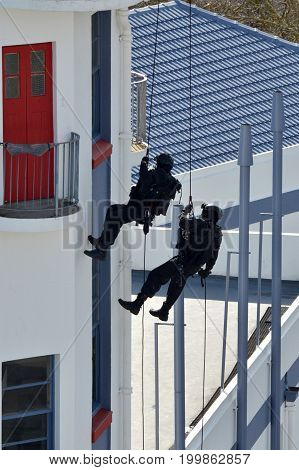 Counter-terrorism Police Officers Abseiling A Building