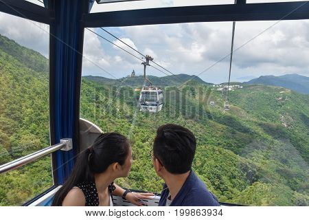 Hong Kong-June 10 2017: a couple is looking for the view on Ngong Ping 360 Cable Car Lantau island Hong Kong