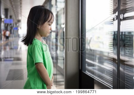 Asian Chinese Little Girl Waiting For Transit