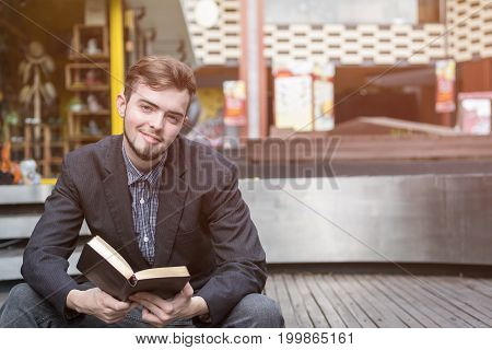 Closeup on a man reading a bible at shopping mall believe concept