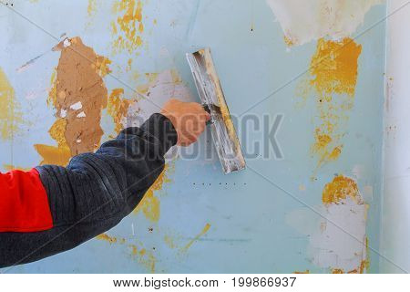 Work Aligns. Putting Plaster On The Wall With Spatula