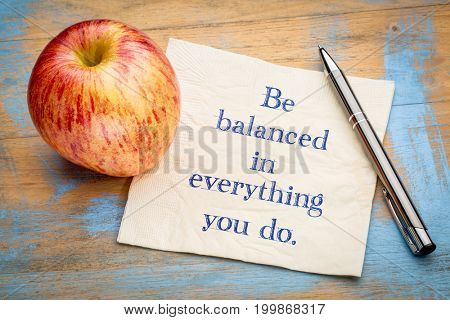 Be balanced in everything you do - handwriting on a napkin with a fresh apple
