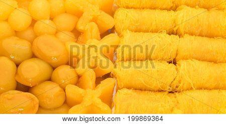 Set of Thai traditional desserts made from egg yolks golden threads (Foi Thong) mock jack fruit seeds (Met Khanoon) sweet egg yolk cap (Thong Yip) egg yolk fudge balls cooked in syrup (Thong yot)