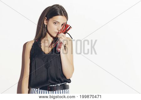 Girl With A Bunch Of Red And Black Licorice.